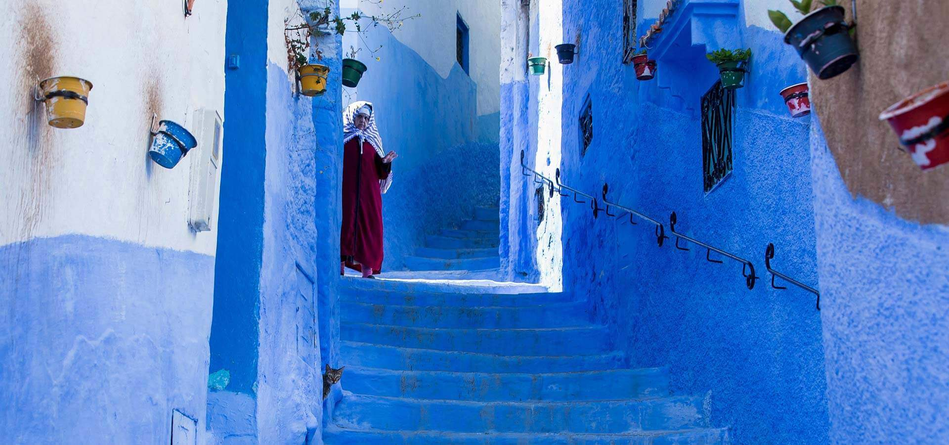 Traditional lady in the blue city of Chefchaouen Morocco